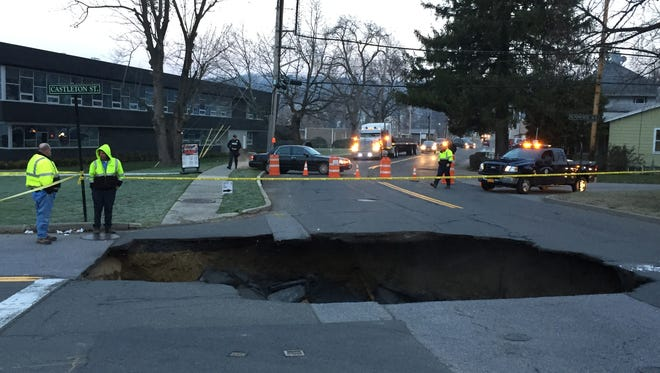 A large sinkhole due to a water main break has closed Marble Avenue in Pleasantville between Sunnyside Avenue and Stanley Street on Monday, Dec. 7, 2015.