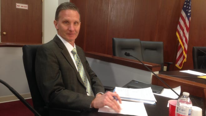 Murfreesboro City Manager Rob Lyons poses before going through a job performance evaluation by the City Council.