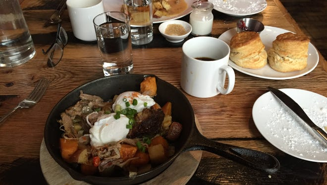 Brunch at Buffalo's Toutant includes a rustic barbecue hash, which varies each week and is served in a cast iron skillet.