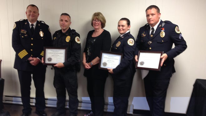 Three Princess Anne police officers received Life Saving Awards are they used Narcan to reverse heroin overdoses in four patients. From left are Chief Timothy Bozman, Sgt. Scott Carew, Matey Barker of the Somerset County Health Department, Offcer  Kara Meeks and Corp. Robert Smith.