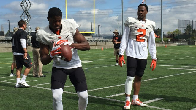 Wide receivers Victor Bolden (left) and Hunter Jarmon warm up before Saturday's scrimmage at Hillsboro Stadium.
