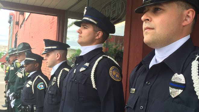 Officers from several county agencies participated in the memorial guard detail Monday.