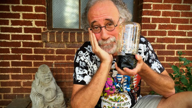 B.J. Leiderman poses with a DIY lantern outside Echo Mountain Recording Studios in Asheville.