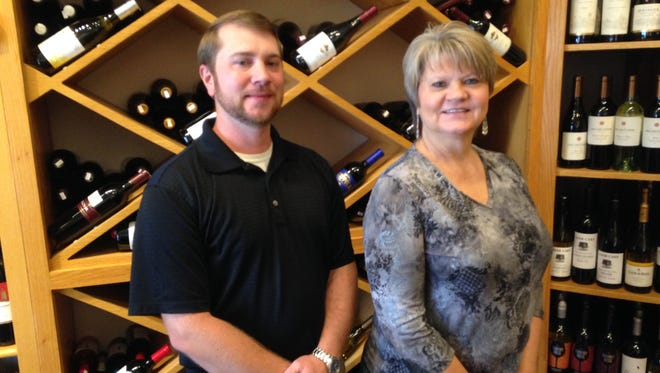 Bryan Borders (left) manages Robert's Package Store & Party Shop in Humboldt, which is owned by his mother, Barbara Graves.