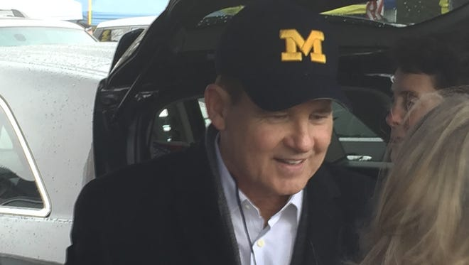 Les Miles enjoys a pre-game tailgate outside Michigan Stadium on Saturday.