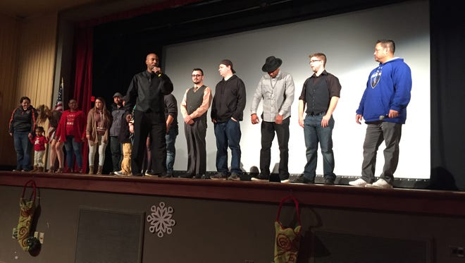 "The cast and production team behind ""Talk Nerdy to Me"" thank the crowd for attending the premiere, which was held Dec. 16 at the Maumee Indoor Theater."