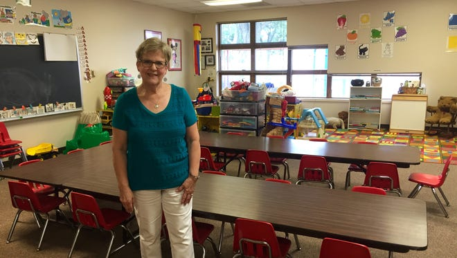Sandy Tams poses in her Sioux Falls Lutheran School preschool classroom. Tams founded the school in 1977.
