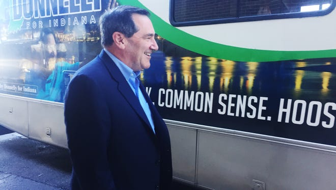 U.S. Sen. Joe Donnelly heads to his campaign RV after a stop at the Downtowner restaurant in Lafayette during a statewide tour announcing his re-election bid.