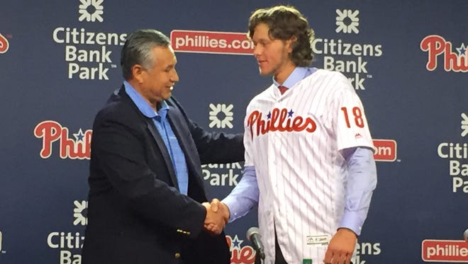 Phillies first-round draft pick Alec Bohm (right), shakes hands with Director of Amateur Scouting Johnny Almarez on Tuesday after the 21-year-old signed with the organization.