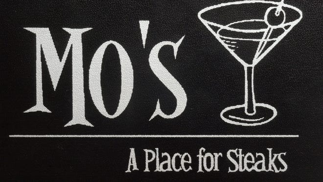 The drink menu at Mo's has the restaurant's logo on the cover. John Severson/ The Star  GENERAL INFORMATION: Tuesday, Sept. 2, 2003. Slug: Slorest12. Assignment #87908. By John Severson. Restaurant review of Mo's a Place for Steaks at 47 S. Pennsylvania St.