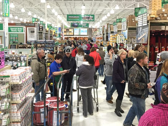 Shoppers fill the aisles on Nov. 27 at Menards in Waite