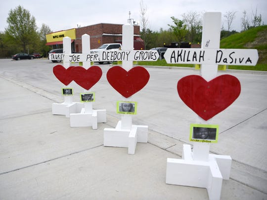 Crosses and hearts are placed in the parking lot at