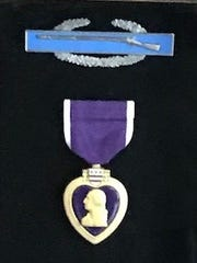 Jerry Donnellan's Purple Heart shows the purple laminate and ribbon normally found in these medals.