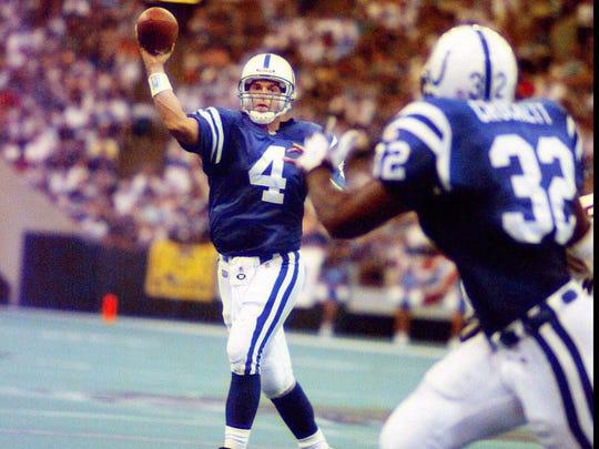 Sun.,9/1/96 (photo by Patrick Schneider)  Indianapolis Colts vs Arizona Cardinals.  Colts' quarterback, Jim Harbaugh (left, #4) throws to Colts' #32 Zack Crockett, running back.