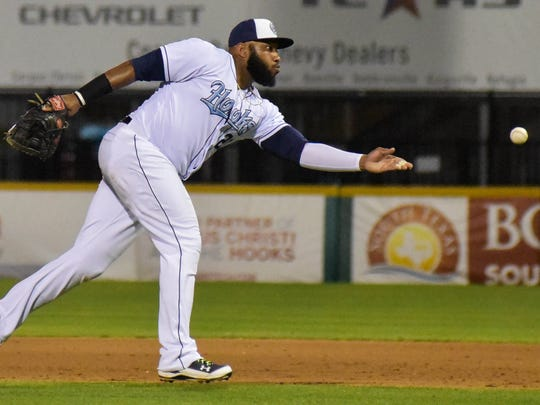 Hooks first baseman Jon Singleton flips a ground ball to first base on May 8, 2017 at Whataburger Field.