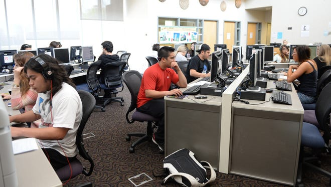Students working in the Open Lab of the Scottsdale Community College Writing Center, where they can also get free tutoring services in writing and foreign languages.