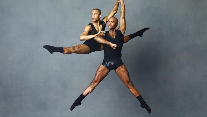 Alvin Ailey American Dance Theater dancers Yannick Lebrun (L) and Glenn Allen Sims.