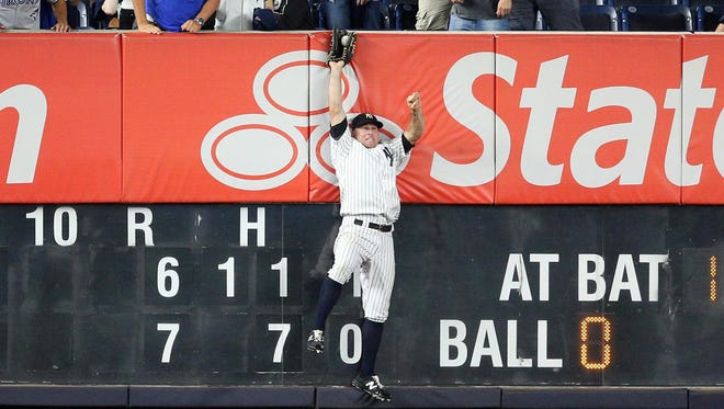 New York Yankees left fielder Brett Gardner catches a fly ball by Blue Jays first baseman Justin Smoak for the final out of Tuesday night's game. Smoak made a bid for a grand slam in the ninth inning with the Yankees clinging to a 7-6 lead.