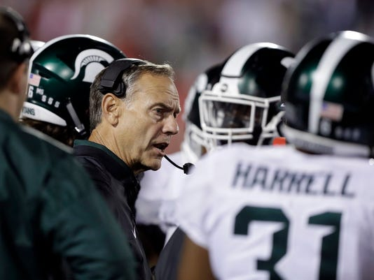 Michigan State coach Mark Dantonio talks with his team during the second half of an NCAA college football game against Indiana, Saturday, Oct. 1, 2016, in Bloomington, Ind. Indiana won in overtime, 24-21. (AP Photo/Darron Cummings)