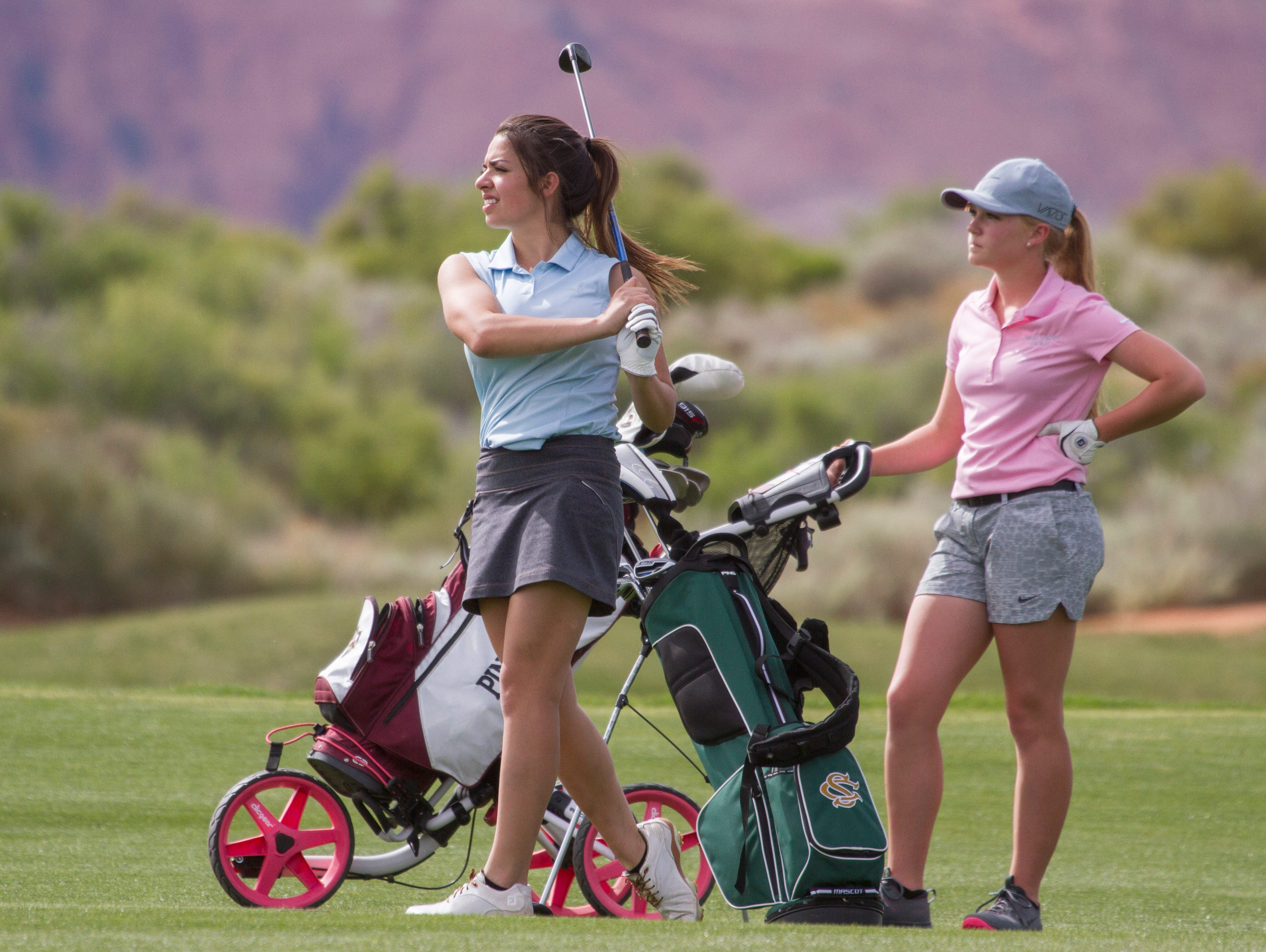 Snow Canyon's Michelle Crenshaw hits a shot on the front nine as Pine View's Bailia Milne looks on at The Ledges Golf Club on Wednesday. The Panthers won its first Region 9 tournament of the season after knocking off Desert Hills.