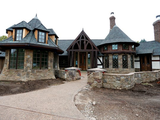 This is an exterior view of the  more than 5,000-square-foot English Tudor style home being built at Pickwick Avenue and Bennett Street.