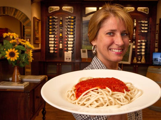 Server Kim DeRitis shows a plate of spagetti at Little