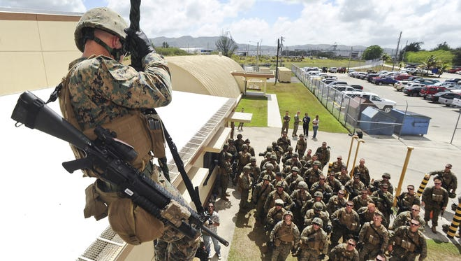 The Defense Department's Office of Inspector General released a report Feb. 1 following an audit to determine whether contracting officials at NAVFAC's Pacific and Marianas offices were properly administering task orders and payments for projects that support the planned relocation of about 5,000 Marines from Okinawa to Guam. In this file photo, members of the 3rd Battalion 6th Marines participate in a fast-rope training exercise at the Explosive Ordnance Disposal Mobil Unit Five rappelling tower on Naval Base Guam.