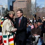 Tears fell and heads bowed Wednesday as Cheyenne and Arapaho tribe members sat on the state Capitol steps Wednesday, listening as Gov. John Hickenlooper apologized for the atrocities of the Sand Creek Massacre.
