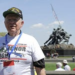 Korean War Marines veteran George Gerken of Lancaster poses for a photo at the Marine Corps War Memorial on Saturday, April 18, 2015. He and 83 other veterans from WWII, the Korean War and the Vietnam War took part in the Honor Flight Columbus trip to Washington DC. The trip allows veterans a chance to see the memorials in the capital free of charge.