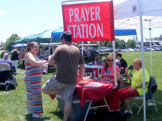 Cindy Hall and Penny Derrer of Lebanon, talk to people at a prayer station.