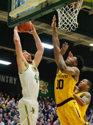 Vermont's Nate Rohrer (44) leaps to dunk the ball during the men's basketball game between the UMBC Retrievers and the Vermont Catamounts at Patrick Gym in January.