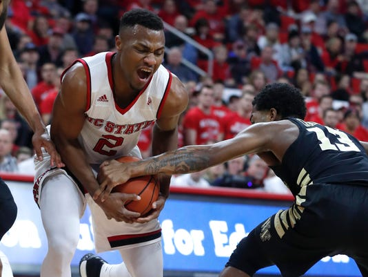 North Carolina State's Torin Dorn (2) drives past Wake Forest's Bryant Crawford (13) during the first half of an NCAA college basketball game in Raleigh, N.C., Thursday, Jan. 18, 2018. (Ethan Hyman/The News & Observer via AP)