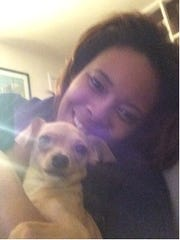 Jackeline Biddle Shuler and a Bobby, a chihuahua at the center of a custody battle, earlier this year in Puerto Rico.