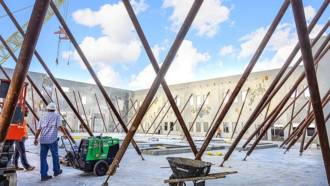 Supports hold up the exterior wall of the new classroom building under construction behind Liberty Pines Academy in St. Johns on Jan. 15, 2020. The building will cost $8.5 million and was funded entirely by half-cent sales tax revenue.