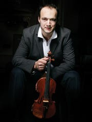 "Peninsula Music Festival Orchestra Concertmaster Igor Yuzefovich is featured in the ""Igor and His Strings"" program Aug. 9."