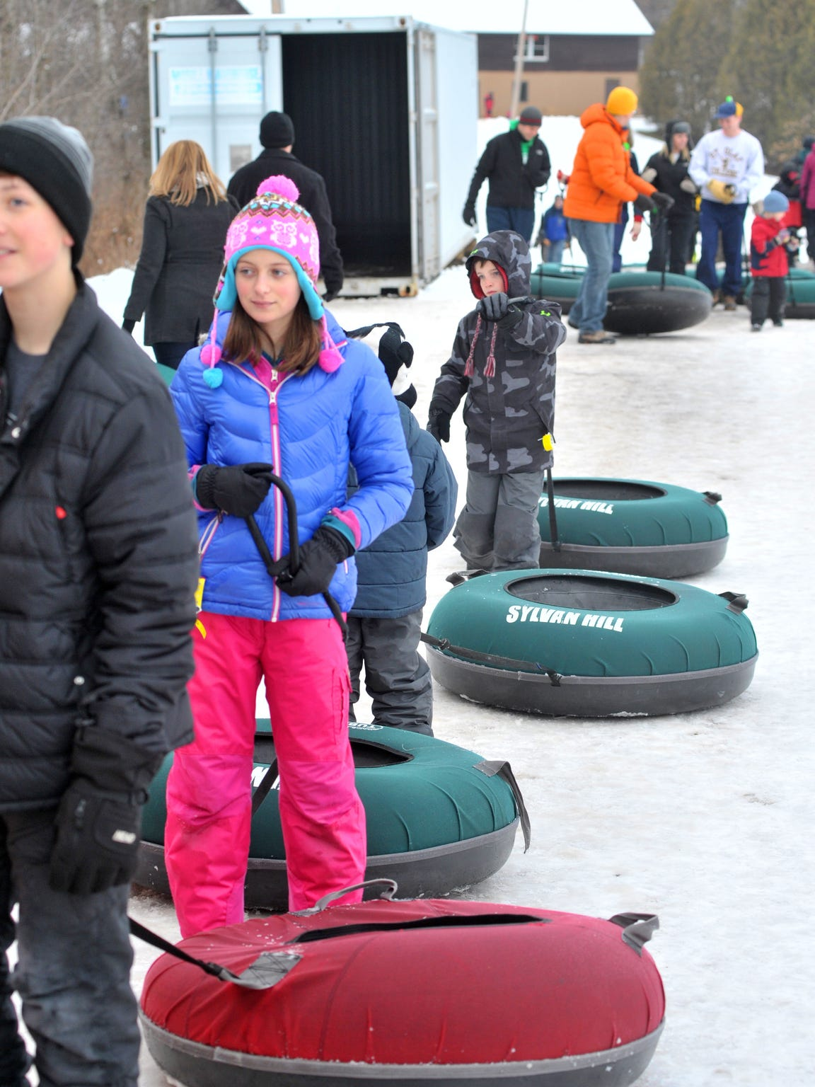 Family members and friends line up to go tubing Friday