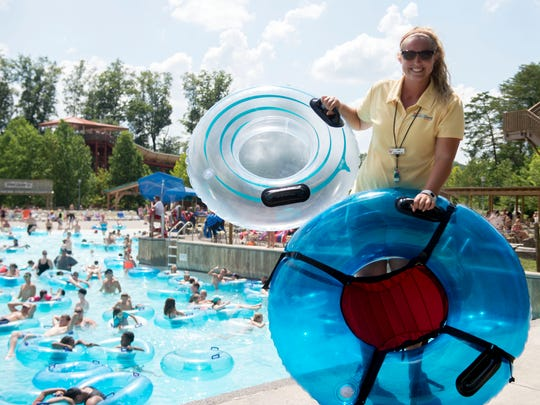 Lauren Lowery, aquatics supervisor for Splash Country with  two new types of tubes for use by people with accessibility or mobility issues. The tubes are designed with a seat that provides additional support.