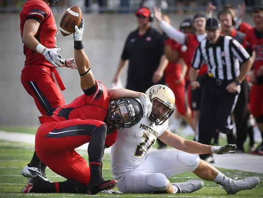 St. Cloud State's Kenneth Walker holds the ball in