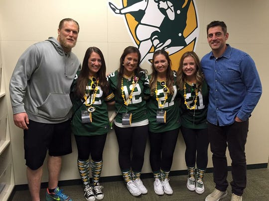 From left, Jessica Waring and sisters Stephanie, Maria and Jamie, all from New York, take a picture with the Green Bay Packers' Clay Matthews and Aaron Rodgers at Lambeau Field after the Oct. 11 game against the St. Louis Rams.