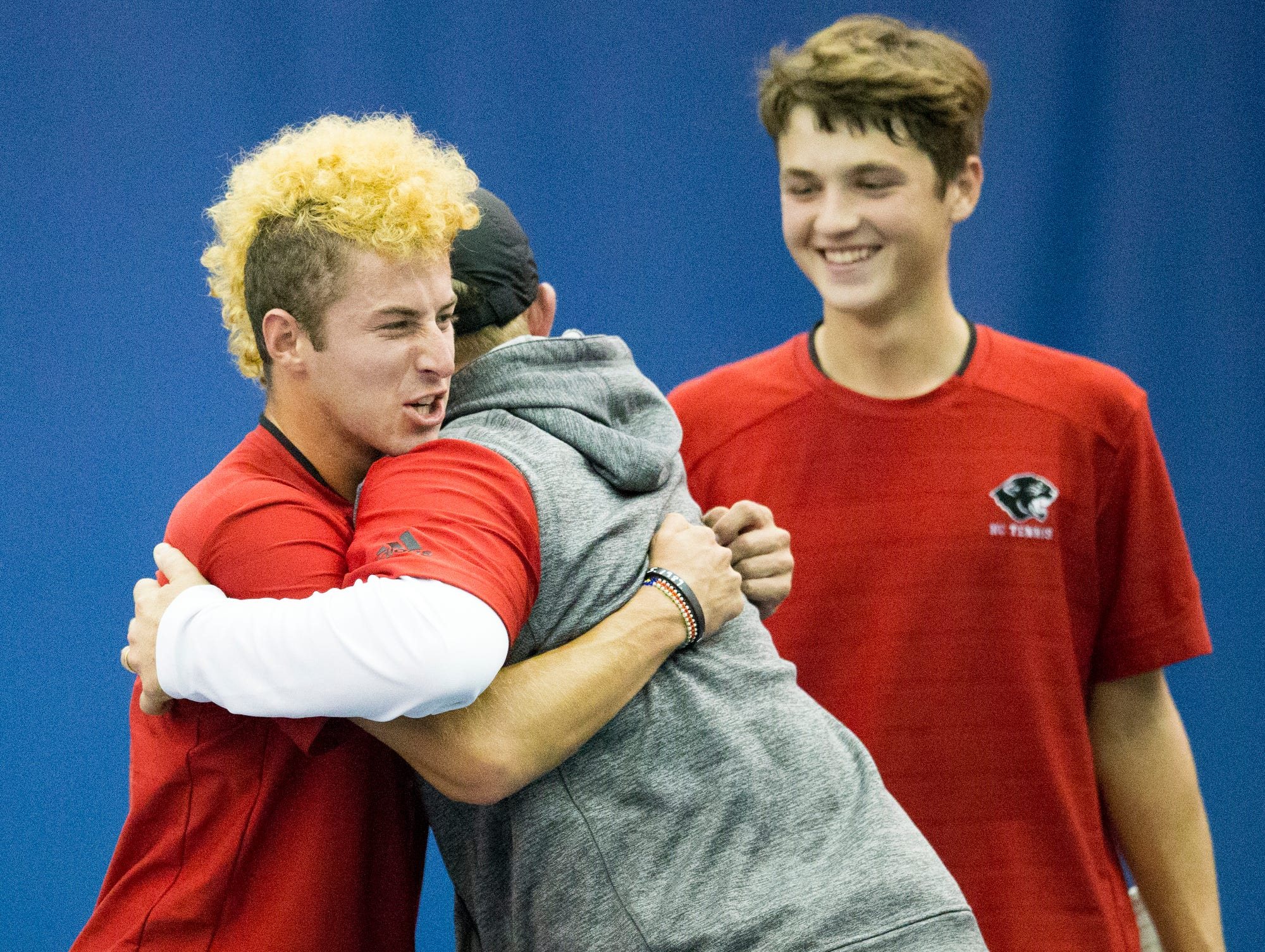 JJ Kroot (left) and doubles partner Jon Tuerk of North Central High School, get a hug after winning, during the IHSAA Boys Individual Tennis State Finals, from Five Seasons, Indianapolis, Saturday, Oct. 24, 2015.