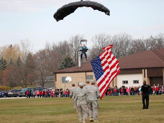 Sam Schaffer of Oshkosh lands in front of Brandon Elementary students and staff to kick off a Veterans Day ceremony Wednesdayl.