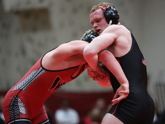 Stevens Point Area Senior High's Fritz Schierl, right, is ranked third at 160 pounds in Division 1 by wiwrestling.com.