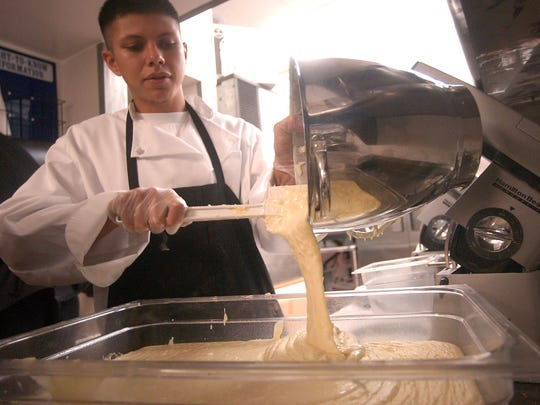 Chris Dominguez of the Rodizio Grill prepares pao de queuo (cheese bread) while working in the kitchen of the restaurant at 200 Jefferson St. Dec. 4, 2008.