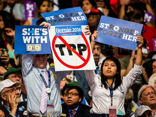 Bernie Sanders supporters protest as Sen. Elizabeth Warren speaks at the Democratic National Convention at the Wells Fargo Center in Philadelphia on Monday.