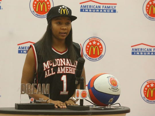 Riverdale's Anastasia Hayes speaks at a press conference where she received her McDonald's All American jersey.