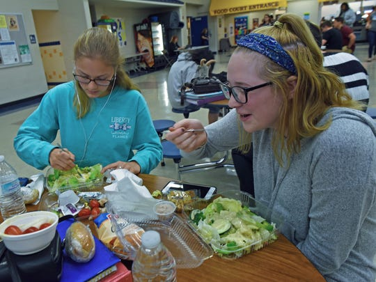 Alexis Kane, left and Madi Hillyard enjoy salads during lunch Wednesday, May 3, 2017 at Waynesboro high school, on May 3, 2017.