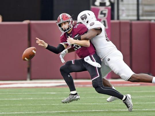 SIU quarterback Tanner Hearn (10) fumbles the ball
