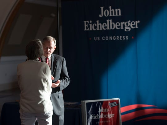 John Eichelberger talks to members of the community