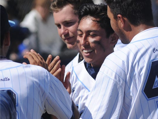 NIck Schopp, center, celebrates with teammates after scoring a run during Camarillo's 6-0 win over visiting Sierra Canyon in a CIF-SS Division 2 quarterfinal game Friday.