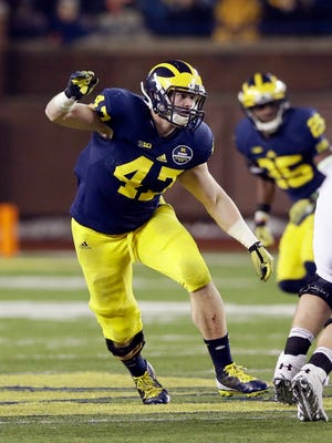 Michigan linebacker Jake Ryan plays against Maryland in Ann Arbor on Saturday, Nov. 22, 2014.